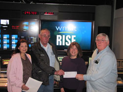 The Fraternal Order of Eagles Rensselaer Aerie # 4446 presents a check to RISE